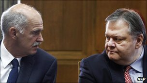 Greek Prime Minister George Papandreou (left) talks to newly appointed Finance Minister Evangelos Venizelos before a cabinet meeting at the parliament in Athens, 17 June 2011