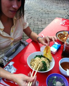 Woman eating in Jakarta