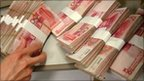 A person handling Chinese yuan bills