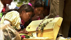 Relatives of victims of Guatemala's civil war try to identify exhumed remains, Zacualpa, Guatemala (5 July 2001)