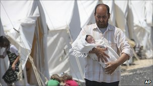 Syrian refugee with baby in Turkish camp