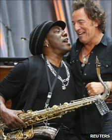 Clarence Clemons (L) grabs Bruce Springsteen during an appearance in New York in September 2007