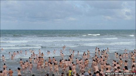 Mass skinny dip at Rhossili on Gower 