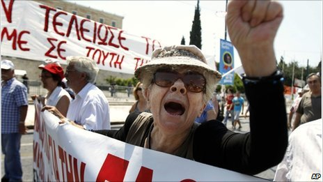 A protester of the Greek Communist party shouts slogans during a rally in Athens on 18 June