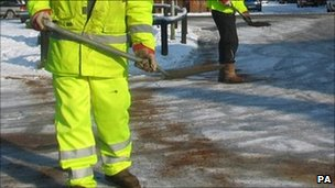 council workers putting grit on roads