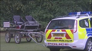 Cart and police car