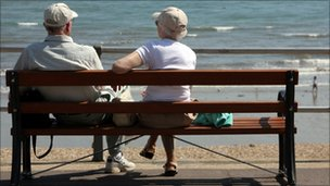 Elderly couple by a beach