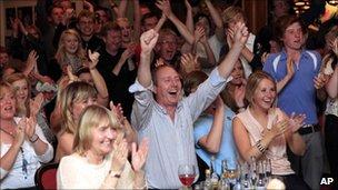 Members of Holywood golf club in Northern Ireland celebrate Rory McIlroy's win