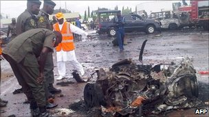Police inspect the wreckage from a bombing in Abuja (archive shot)