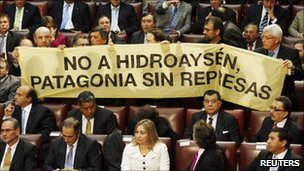 "Opposition deputies hold up a placard in protest against the dam during Chile""s President Sebastian Pinera's annual address at the national congress building in Valparaiso city on 21 May, 2011"