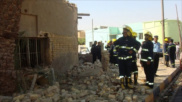 Emergency workers gather at the site of a bomb attack in Diwaniya