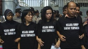 Protest outside the Saudi embassy in Jakarta. the t-shirts read: corrupt government, workers are beheaded