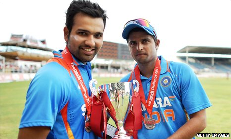 India's Rohit Sharma and stand-in captain Suresh Raina with the one-day international series trophy