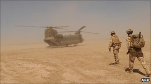 Soldiers and military helicopter