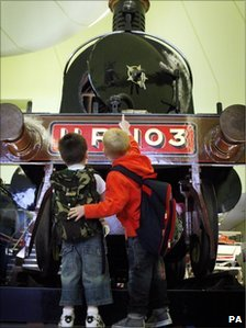 Two young visitors view an exhibit at the Riverside Museum in Glasgow