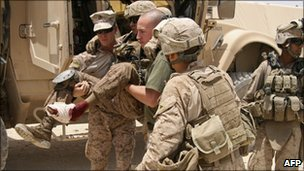 US troops carry injured comrade