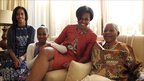 Michelle Obama and her daughters Malia (L) and Sasha (2L) meet Nelson Mandela in Johannesburg, South Africa (21 June 2011)