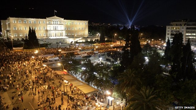 Protesters swarm to the Greek parliament in Athens after a vote of confidence in the government