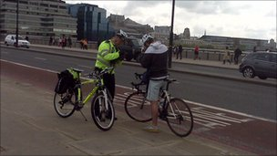 Cyclist getting a ticket