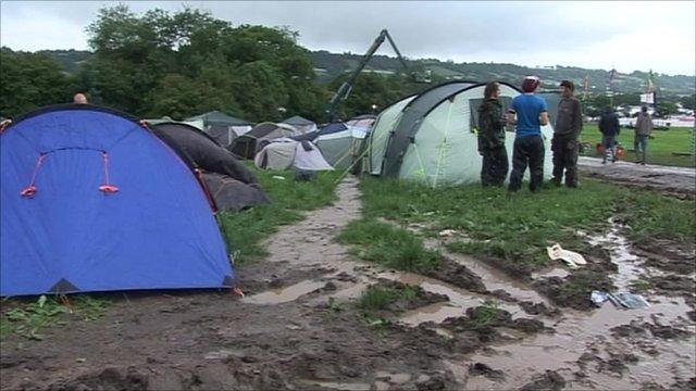Tents in muddy field