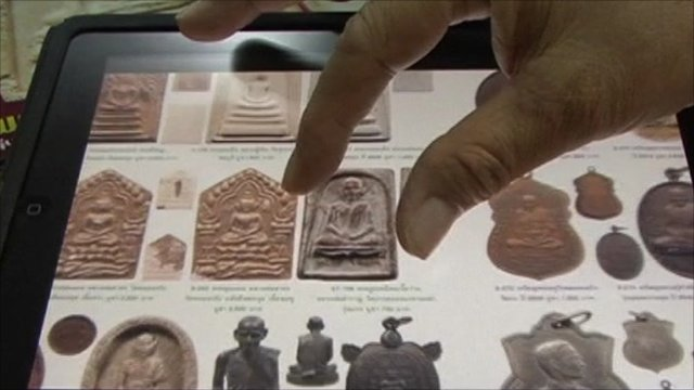 Image of Buddhist amulet on iPad