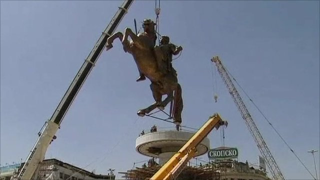 Statue of Alexander the Great being lowered onto its plinth