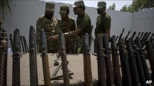 Pakistani soldiers with weapons confiscated from alleged militants in the Mohmand tribal region (June 2011)