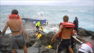 People clamber on the rocky shore on Christmas Island, Australia (file photo 15 December 2010)