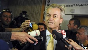Geert Wilders speaks to reporters after his acquittal in Amsterdam, 23 June