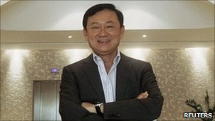 Thailand's former Prime Minister Thaksin Shinawatra poses for a photograph at his residence in Dubai