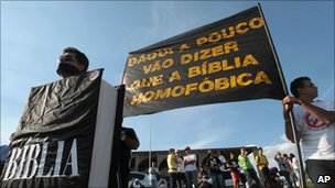 "People belonging to several different religious groups, protest in Brasilia against same-sex civil unions  with a banner that reads: ""Pretty soon people will say the Bible is homophobic."" - 1 June 2011"