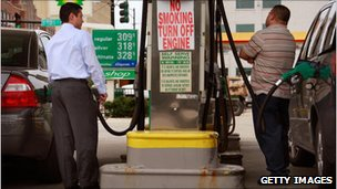 Two men fill up their cars