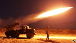 Rebel fighters fire a Grad rocket at the front line west of Misrata, Libya, Monday, 20 June 2011