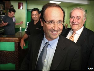 Francois Hollande (foreground) visiting the north-western French town of Revin, 14 June 2011