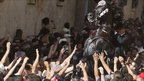 A horse rears in a crowd during the traditional St John festival in the town of Ciutadella, on the island of Minorca, Spain.