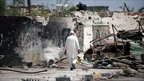 An elderly man walks through rubble in the Libyan city of Misrata