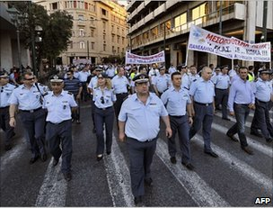 Greek police, coast guard and fire brigade trade unionists march against the cuts in Athens, 23 June