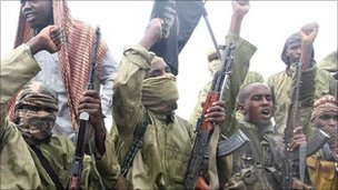 Islamist fighters from al-Shabab chant slogans in Mogadishu (Archive shot: October 2009)