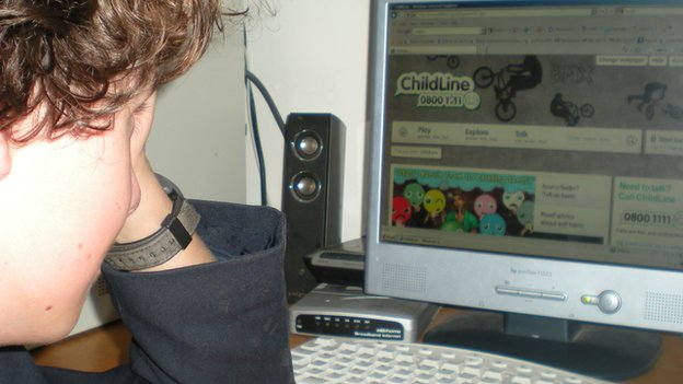Boy looking at Childline website