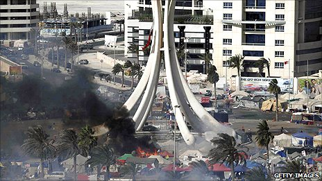 Protesters' tents burn in Manama's Pearl Square in March 2011