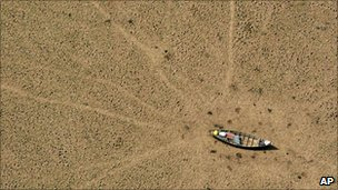Boat stranded on dry Amazon ground