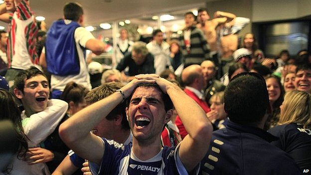 Football fans react to their team losing