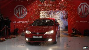 A new MG6 vehicle is unveiled at the Chinese-owned MG factory in Longbridge on 13 April 2011