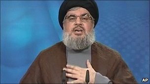 Hezbollah leader Hassan Nasrallah gestures as he delivers a message broadcast on 24 June, 2011