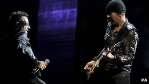 Bono and The Edge perform