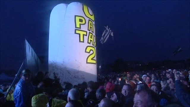 "A balloon with the words ""U Pay Your Tax 2"" in the Glastonbury crowd"