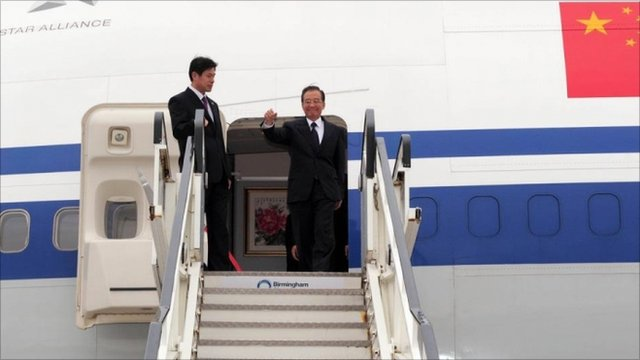 Chinese premier Wen Jiabao (right) arrives at Birmingham airport
