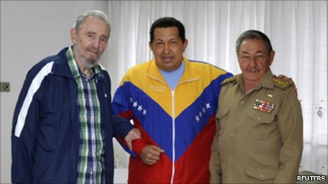 Handout photo of Venezuelan President Hugo Chavez (C) being visited by Cuban President Raul Castro (R) and its revolutionary leader Fidel Castro at a hospital in Havana on 17 June 