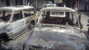 Damaged vehicles at the police station in Kolachi, Pakistan