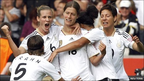 Germany celebrate Garefrekes' opening goal against Canada